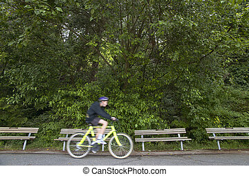 Cyclist in Stanley Park. Vancouver. Canada. Horizontal...