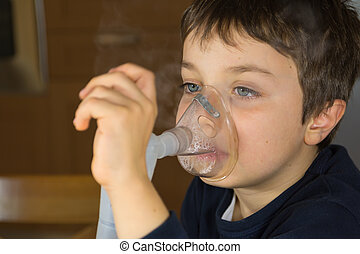 child with electric nebulizer - kid with mask for...