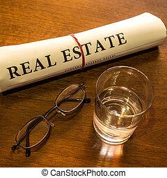 real estate newspaper on desk