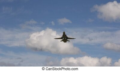 jet military plane Su-24 flies overhead close.
