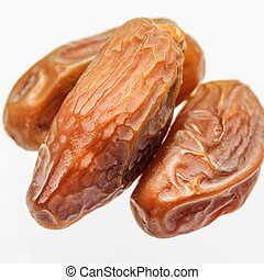 dates - dried dates isolated on white background