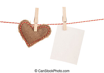 Photo frame and valentines day toy heart hanging on rope...