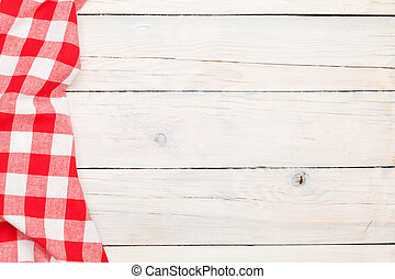 Red towel over wooden kitchen table View from above with...