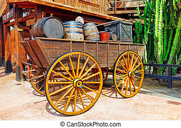 Old cart with wine barrels.Wild West.