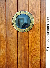 an antique doorway with porthole from a ship