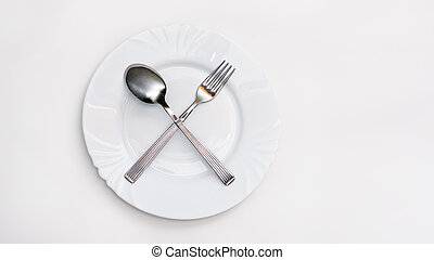 Fork, spoon and white plate - Plate, fork and spoon on white