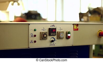 Control panel of machine in production workshop
