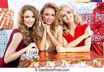 Attractive girlfriends with Christmas gifts - Attractive...