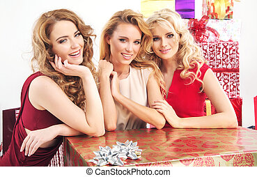 Three pretty women with huge present - Three pretty ladies...