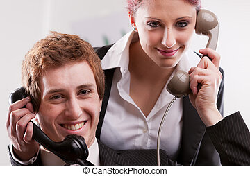 office workers in a call center with phones