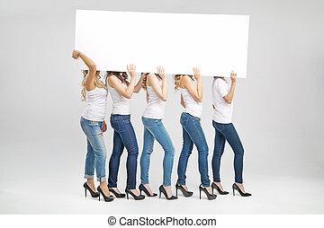 Shapely women carrying white board - Shapely women carrying...