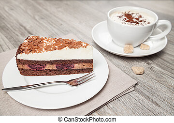 cake and coffee on wood table