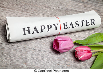 """""""happy easter"""" newspaper and tulips"""