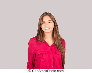 Young Latin Girl, wearing a pink shirt, standing and looking...