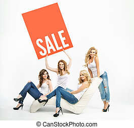 Attractive women promoting middle-season sale - Attractive...