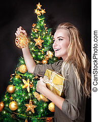 Happy girl decorating Christmas tree - Portrait of cute...