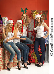 Four alluring girls promoting the Christmas - Four alluring...