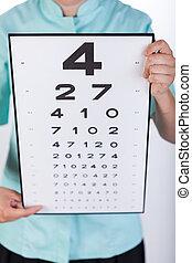 Snellen test - Eye specialist holding snellen test used to...