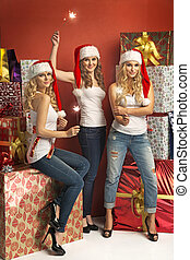 Three gorgeous women holding sparklers