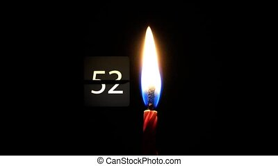 A minute of silence. Candle burning in the night