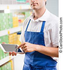 ventas, oficinista, con, tableta,
