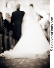 Bride and father in church defocused - Bride in white dress...