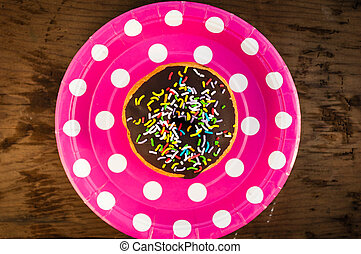 Bright donut on the plate.