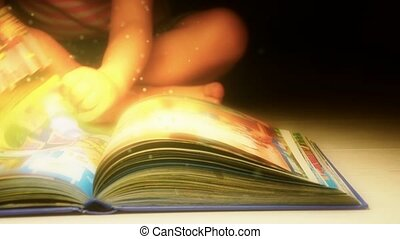 Child reading a book The book of fairy tales and mysteries...
