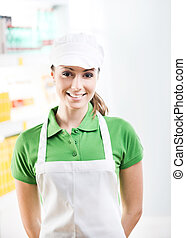 Female sales clerk working at supermarket - Young smiling...