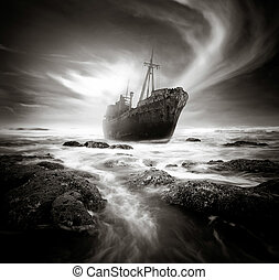 The Shipwreck - Shipwreck along a rough and rocky coastline.