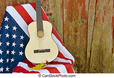 guitar on American flag - Guitar and autumn leaves on an...