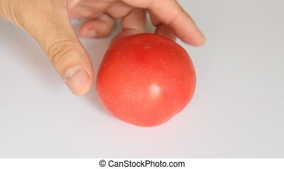 Male hands slicing red tomato, dolly shot