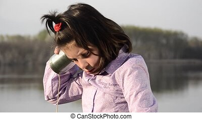 a funny phone - Little girl and her new mobile phone Tin can...