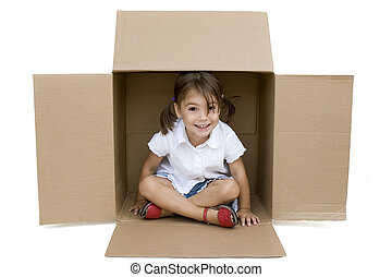 girl inside a Box - little girl inside a Box isolated on...