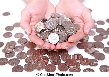 100 yen coins with hands - many Japanese 100 yen coins with...