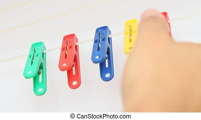 Colorful clothes pins on a rope - Colorful clothes pegs on a...