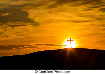 Bright Sunset Cross - Cross on a hill with a bright sun...