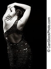 Woman in sparkly dress facing away