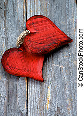 Valentine - Two Wooden Red Hearts isolated on Rustic Wooden...