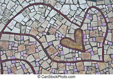 Love mosaic - mosaic with a small heart on the ground