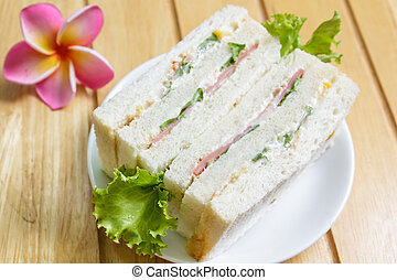 Sandwich with ham - sandwich with ham on wood background,...