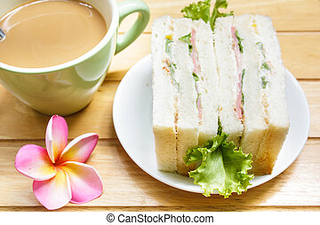 Sandwich with ham. - sandwich with ham on wood background,...