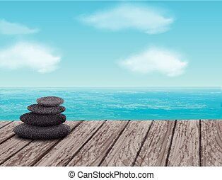 pebbles stack over sea - pebbles stack isolated on wooden...