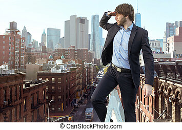 Handsome young man on the top of the city
