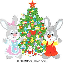 Rabbits and Christmas tree - Little bunnies with a festively...