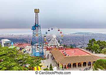 Barcelona city from mountain top Tibidabo. Catalonia, Spain.