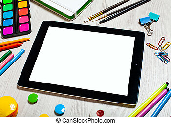 Tablet with blank screen on table with office tools - Black...