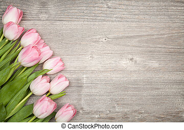 bouquet of tulips border design on wood table