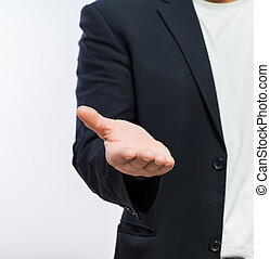 Businessman offering for handshake over white background...