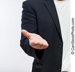 Businessman offering for handshake over white background....
